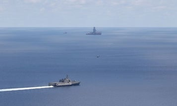 The Navy warns China to stop 'bullying' others in the South China Sea as its ships sail into a standoff