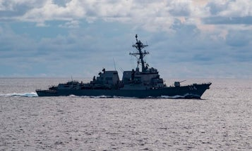 Navy warship challenges China in South China Sea as US blasts Beijing's 'gangster tactics'