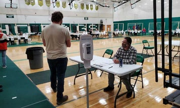 Army National Guardsmen are working at election polling sites out of uniform