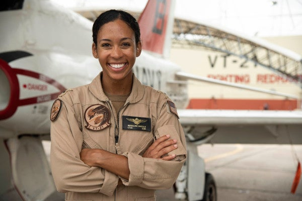 The Navy's first Black female fighter pilot has officially earned her Wings of Gold