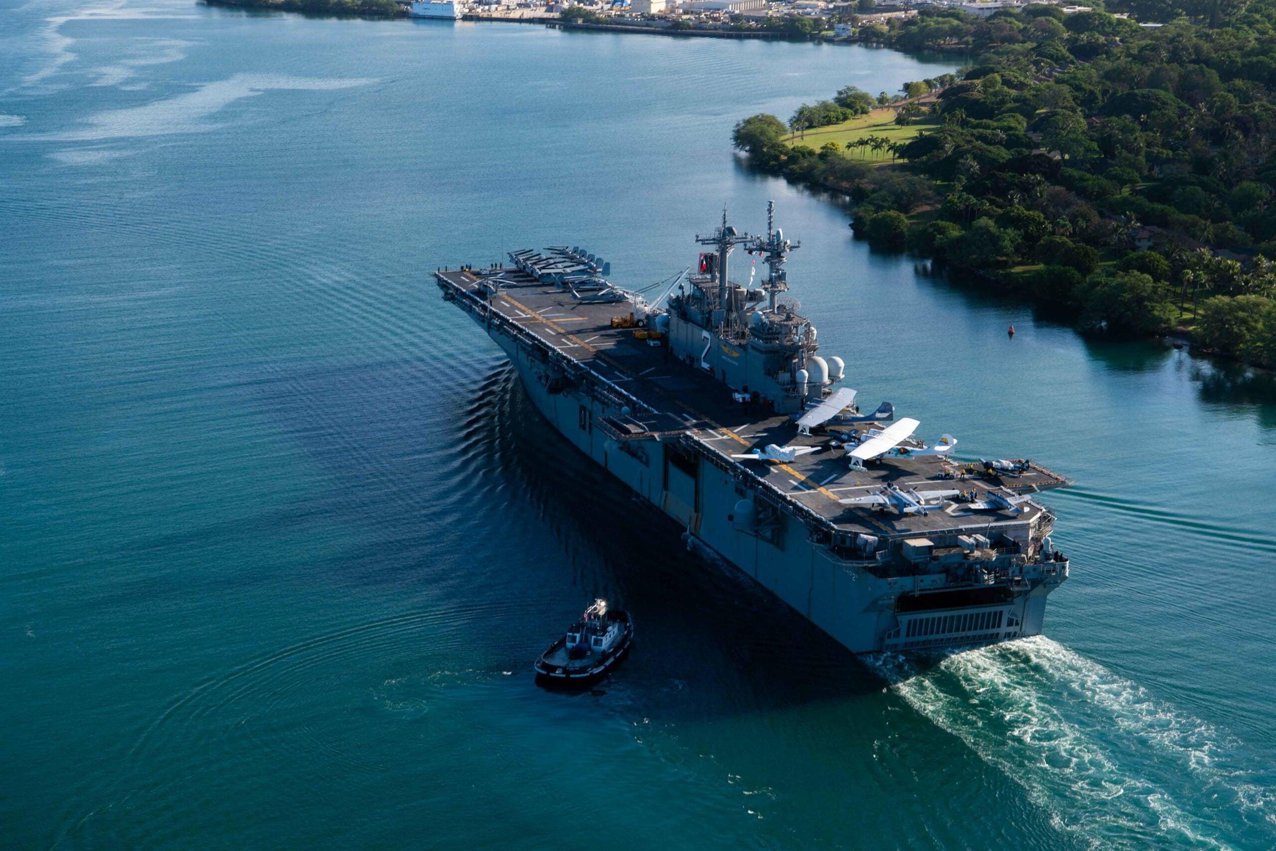 A Navy flattop just rolled up in Hawaii laden with World War II-era warbirds