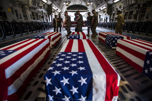 With honor ceremony, Marines and sailor who died in ocean training exercise are flown to Dover Air Force Base