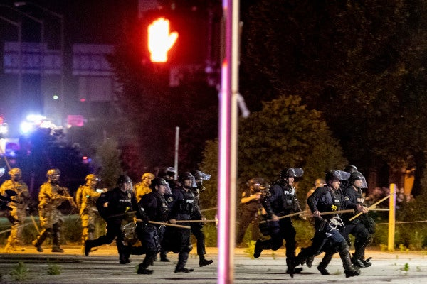 One dead in Louisville after shooting involving police and National Guard amid protests