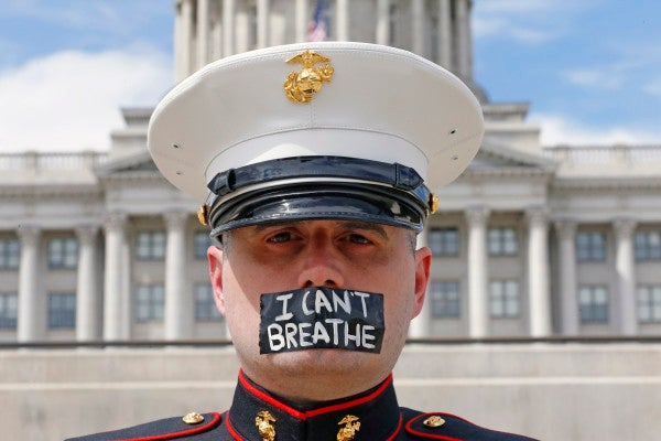 A Marine vet stood in silent protest outside the Utah Capitol so long that his shoes melted