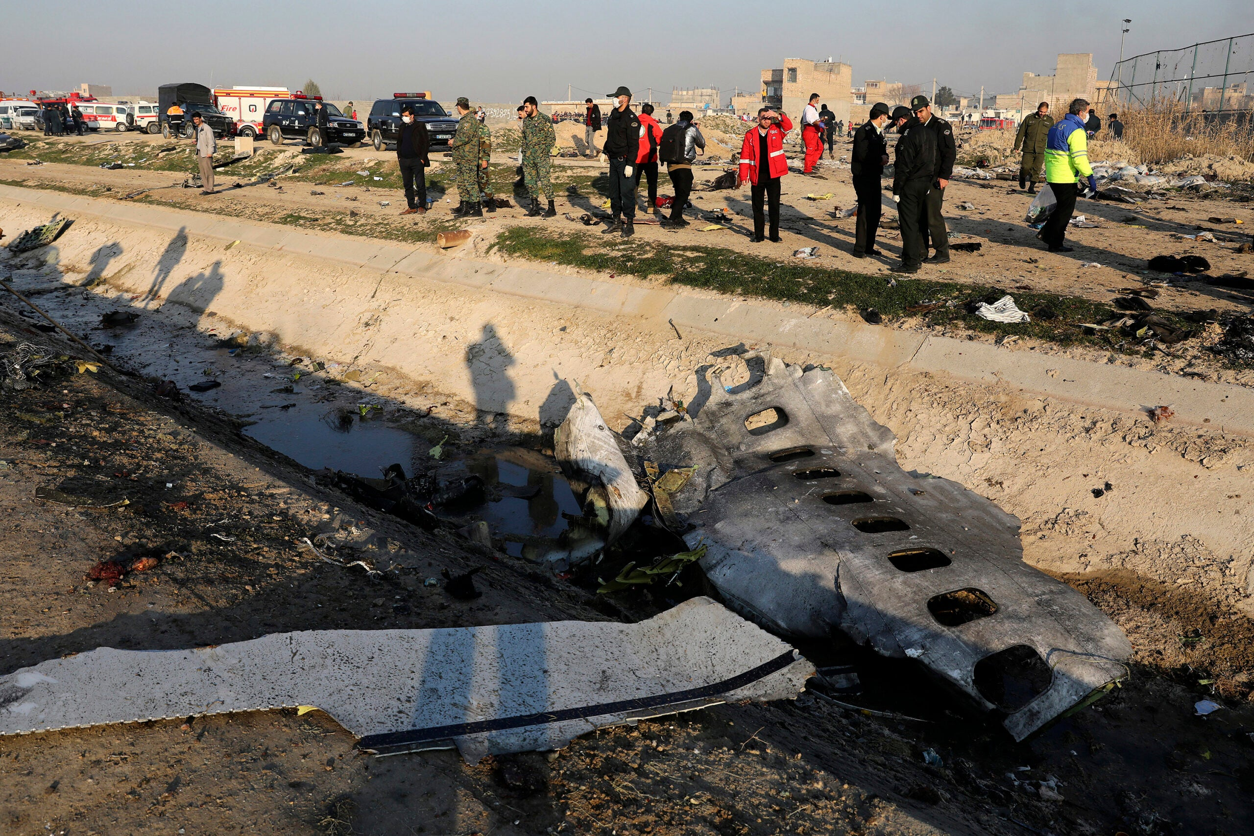 Iran says Ukrainian passenger plane shot down in January was hit by two missiles 25 seconds apart