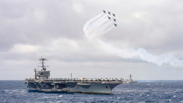 Watch the Blue Angels fly over a Navy aircraft carrier from inside the cockpit of an F/A-18 Hornet