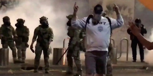 Watch this Navy veteran shrug off batons and pepper spray like a badass amid protests in Portland