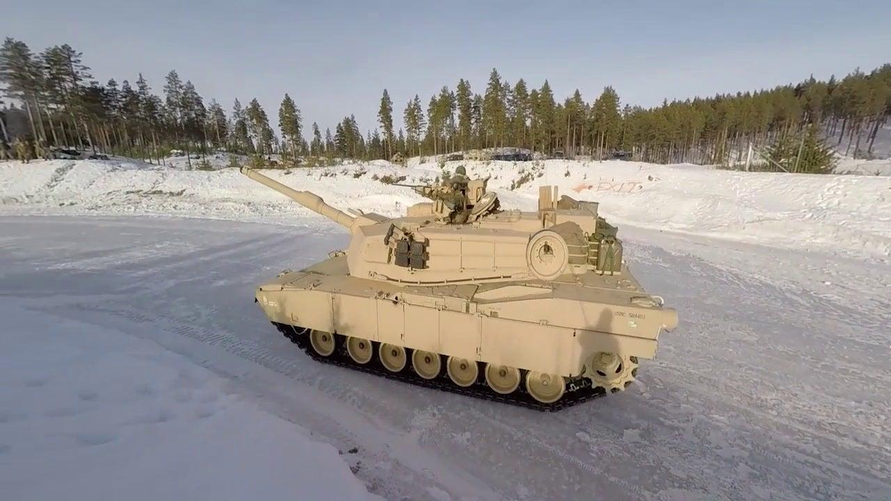 Marine Corps tanks slip on the ice in Norway