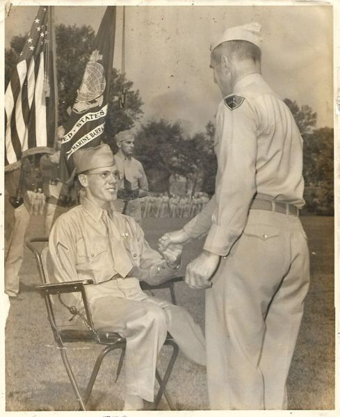 He lost his arm, leg and eye saving his fellow Marines during WWII. Now his family says he deserves the Medal of Honor