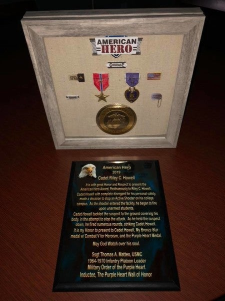 Decorated Vietnam vet presents Purple Heart and Bronze Star to family of slain UNC Charlotte shooting hero