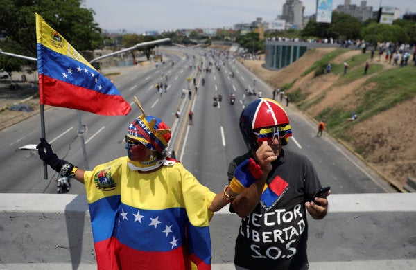 Thousands take to the streets in Venezuela to force Maduro from power