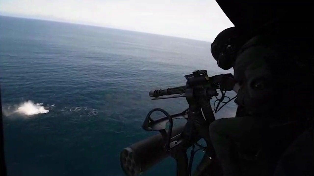 Marine Fires GAU-17 minigun from a UH-1Y Venom