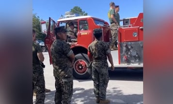 It looks like a US Marine bought a fire truck. And yes, that's totally allowed