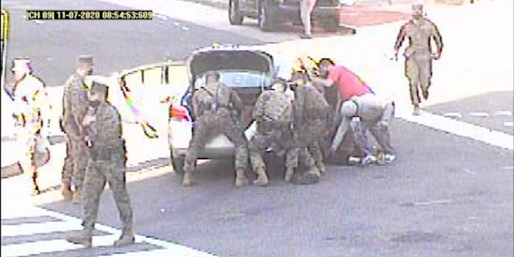 We salute these Marines for saving the life of a woman trapped underneath a car