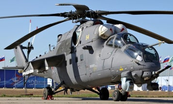 A Russian military helicopter accidentally opened fire on an apartment building