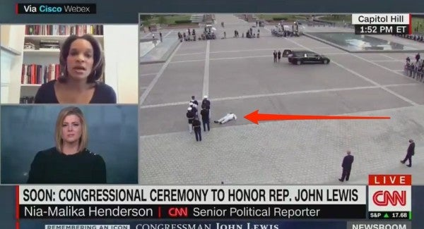Sailor collapses from heat and dehydration while serving with Rep. John Lewis' honor guard