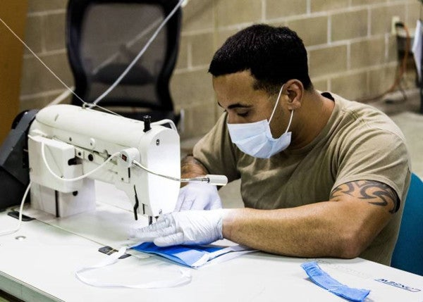 Army parachute-riggers use their skills to sew COVID-19 surgical masks