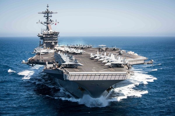 A US aircraft carrier could be stuck in port for almost a month for COVID-19 testing, but the Navy is trying to cut that time down