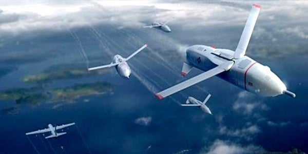 DARPA's 'Gremlin' Drones Can Deploy From A Flying Carrier In Starcraft-Style Swarms
