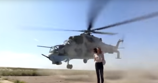 TV Broadcaster Completely Unfazed As Attack Helicopter Nearly Takes Her Head Off