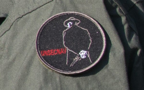 We salute the acting undersecretary of the Navy for rocking a Clint Eastwood patch on his flight suit