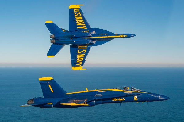 Watch the Blue Angels' legacy F/A-18 Hornets make their final sunset flight after 34 years