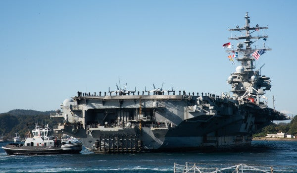 We salute the USS Ronald Reagan for rocking its battle flag on its way back to port