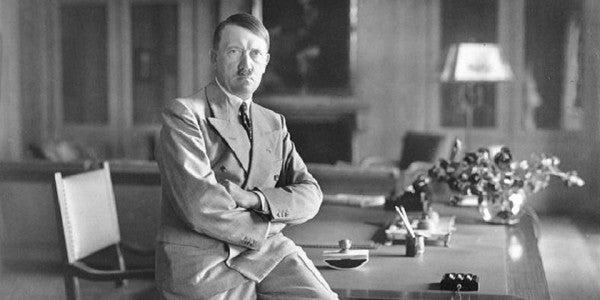Hitler Sitting on Desk
