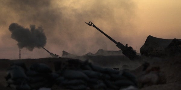 Watch This Incredible Footage Of Marines Striking ISIS Fighters With Artillery In Syria