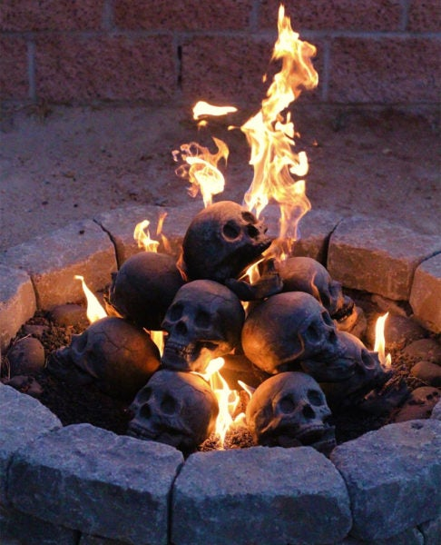 Turn Any Bonfire Into Hellfire With These Metal-As-F*ck Steel Skull Logs