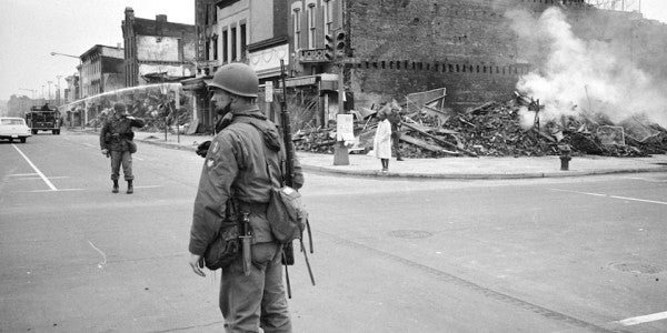 Black and White Photo of Solider on Street