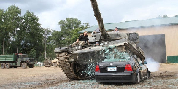 This Theme Park Lets You Drive A F**king Tank Through A House