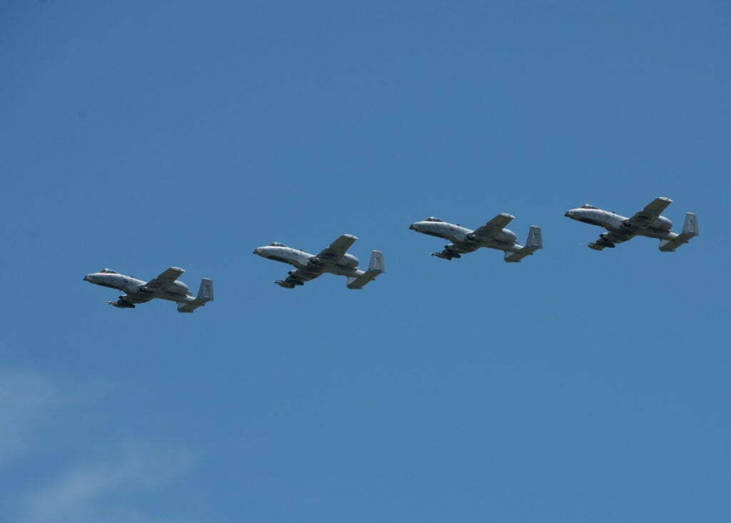 Four A-10 Thunderbolt IIs with the 442nd Fighter Wing fly in formation during the Wings Over Whiteman airshow on June 15, 2019, at Whiteman Air Force Base, Missouri.  (U.S. Air Force/ Airman 1st Class Parker J. McCauley)