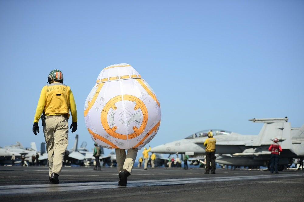 We salute the sailor who walked the flight deck in a Star Wars droid costume