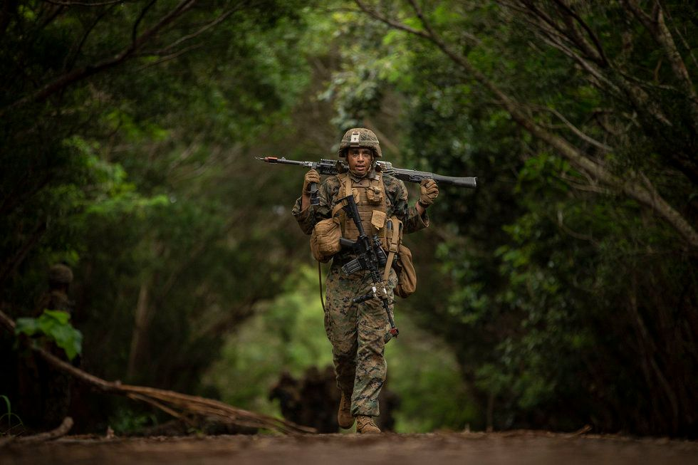 Marine in Fatigues Walking in Woods