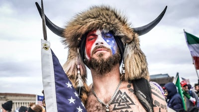 The 'QAnon shaman' guy got kicked out of the Navy for refusing a vaccine