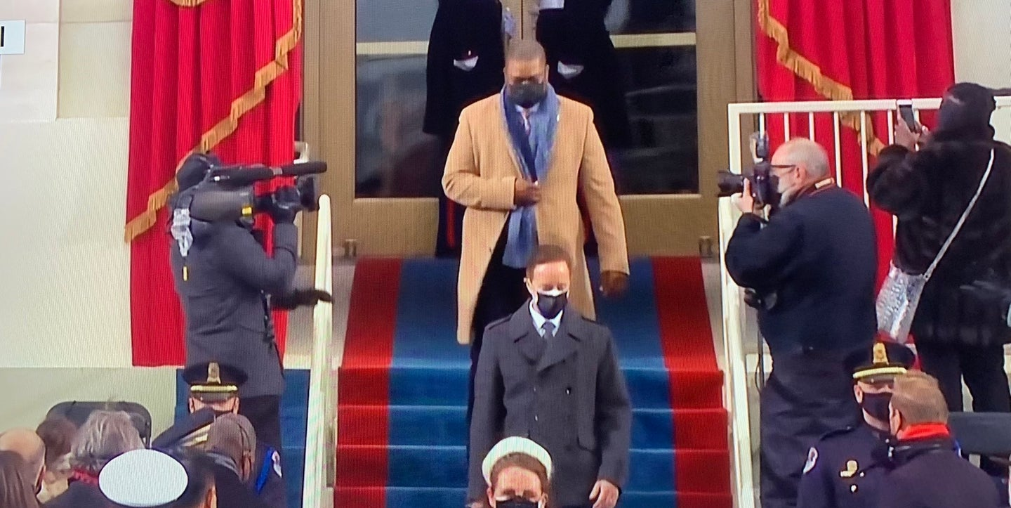 Army vet, Capitol officer who held off mob escorts Harris at inauguration