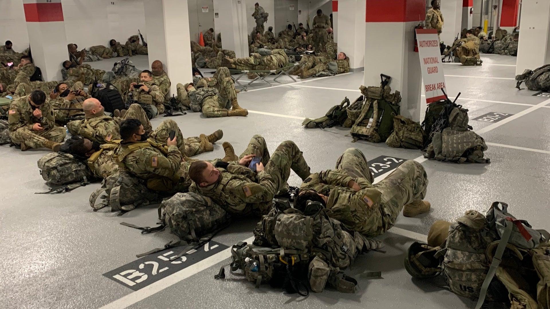 National Guardsmen sleep in parking garages following Biden inauguration