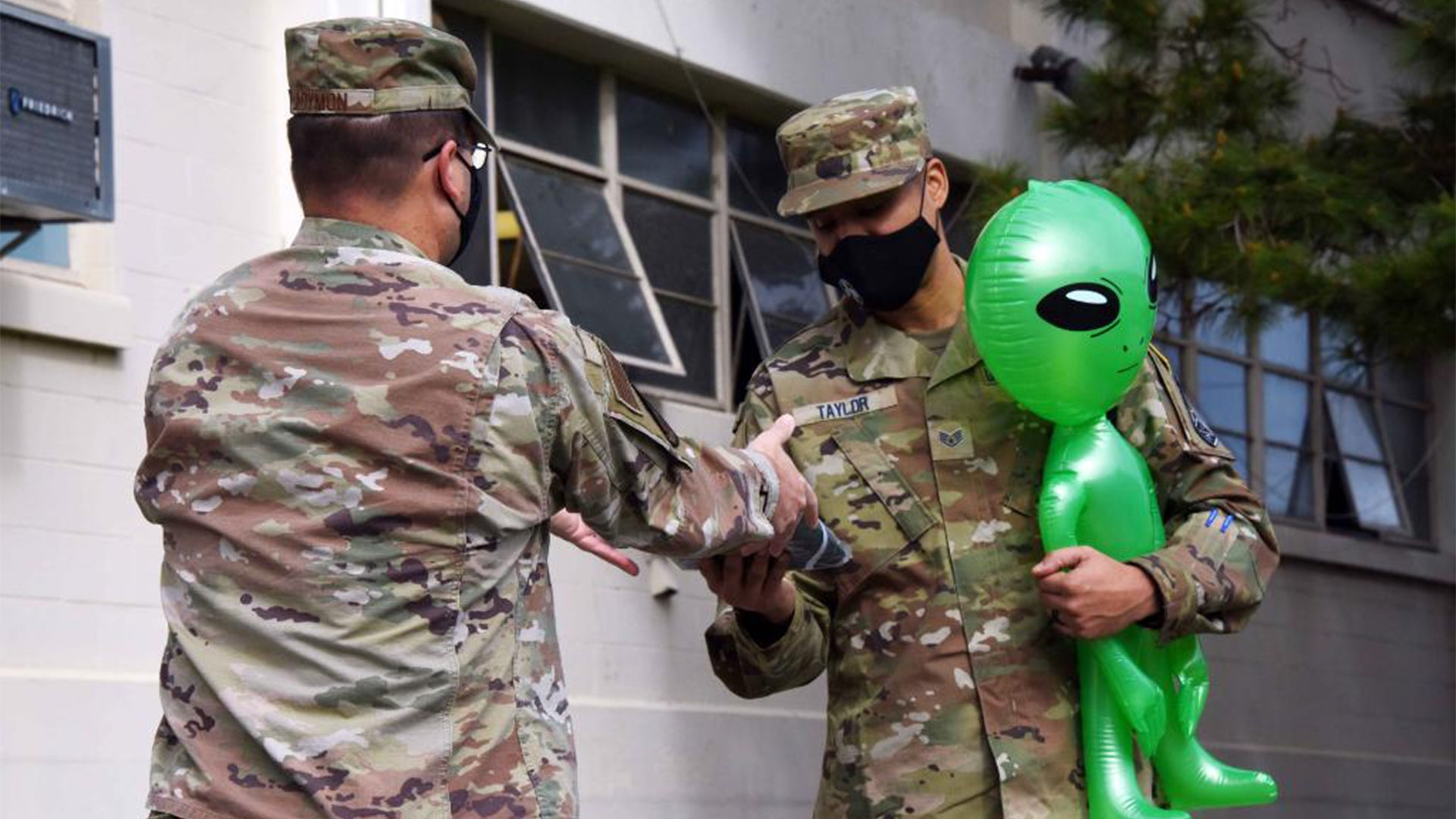 This service member just enlisted in the Space Force with his alien pal by his side