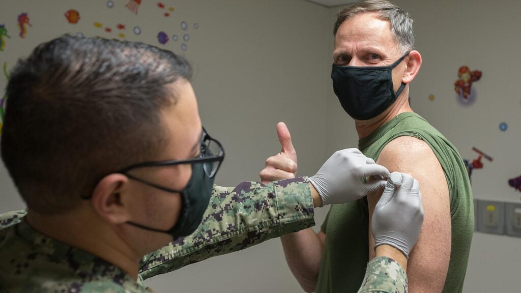 Mandatory COVID-19 vaccine means troops have one more prick to deal with