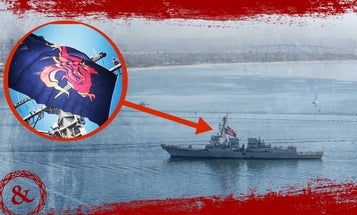 We salute the USS Sterett for flying this badass battle flag on the way back to port