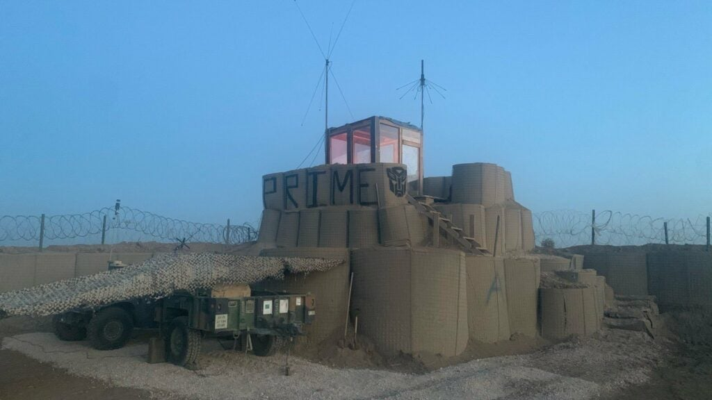 We salute the 4 soldiers who shoveled 1.6 million pounds of sand to build this HESCO tower