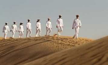 Why the hell are these Dutch sailors strolling through the desert in dress whites?