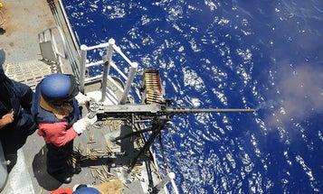 Coast Guard fires warning shots after 13 Iranian boats menace warships in the Strait of Hormuz