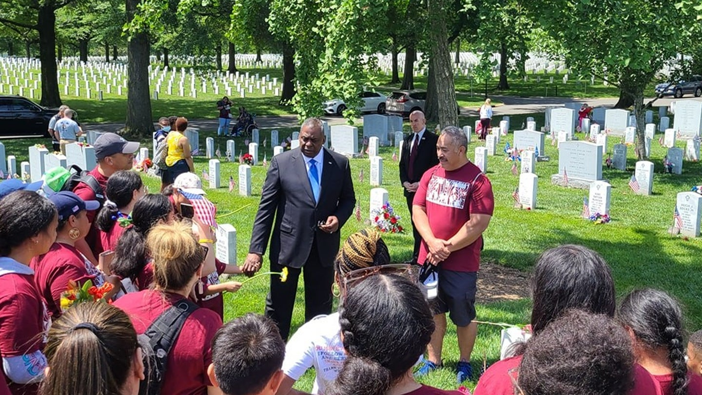 The story behind a viral video of Defense Secretary Lloyd Austin surprising a group laying wreaths at Arlington Cemetery