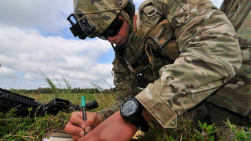 U.S. Air Force Airman 1st Class Joshua Darins fills out a simulated nine line medevac request during training at Warren Grove Gunnery Range in Ocean County, N.J. on Aug. 29. Darins is a tactical air control party airman assigned to the 227th Air Support Operations Squadron, 177th Fighter Wing, New Jersey Air National Guard. (U.S. Air National Guard photo by Master Sgt. Andrew J. Moseley/Released)