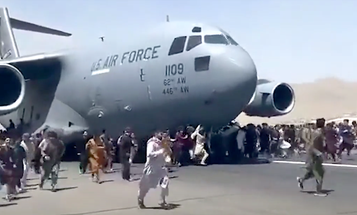 Afghans are literally clinging to the sides of US military aircraft to escape the Taliban sweep of Kabul