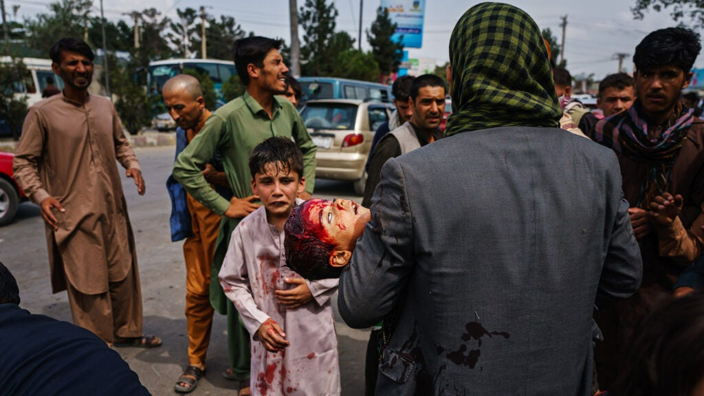 Taliban fighters have created a 'gauntlet' outside Kabul's airport making escape nearly impossible