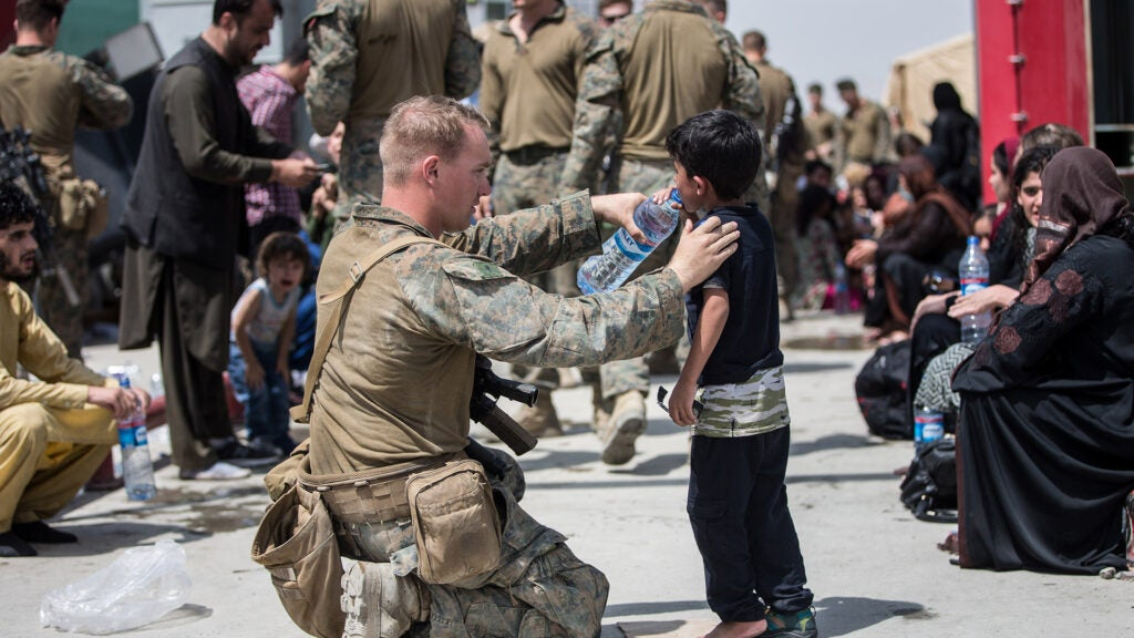 As a sea of humanity fights to escape the Taliban, an Afghan interpreter and his family make it to safety