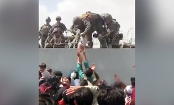 Watch a US Marine take an Afghan baby to safety inside the walls of the Kabul airport